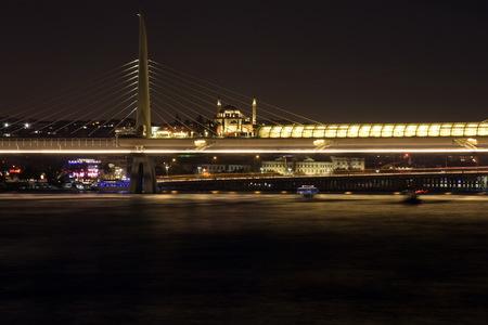 Istanbul skyline from Galata bridge at night, long exposure, Turkey
