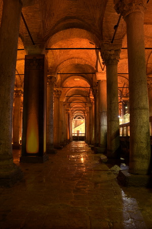 ISTANBUL, TURKEY - AUGUST 08, 2017: The Basilica Cistern in Turkish Yerebatan Sarnıcı, means Cistern sinking into Ground, its largest saving water place in the city, Medusa statue is located there.