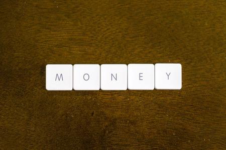 MONEY word written on plastic keyboard alphabet with dark background Archivio Fotografico