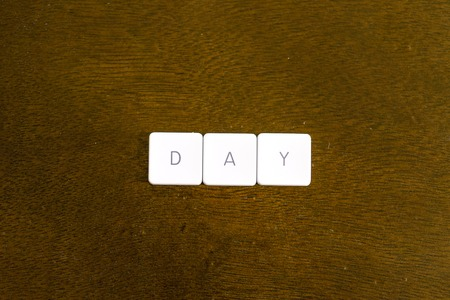 DAY word written on plastic keyboard alphabet with dark background Archivio Fotografico - 101591377