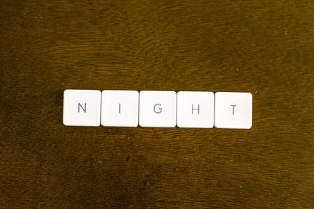 NIGHT word written on plastic keyboard alphabet with dark background Archivio Fotografico - 101588232