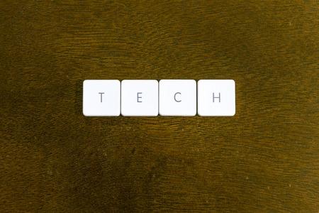 TECH word written on plastic keyboard alphabet with dark background Archivio Fotografico