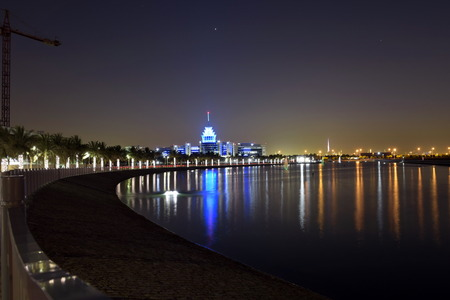 Dubai, United Arab Emirates - May 21, 2018: Dubai Silicon Oasis Headquarters Building with Lake view at night, Established in 2014 a free zone owned by the Government of Dubai.