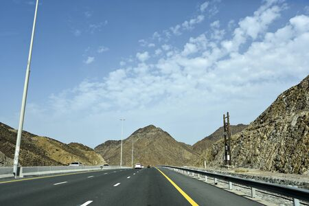 New Dubai -  Fujairah Road, Sheikh Khalifa Bin Zayed Road, Ras Al Khaimah – Fujairah, United Arab Emirates, June 4, 2019. Around 40 minutes make shorter Dubai to Fujairah. Stock Photo