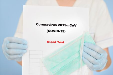 Nurse with COVID-19 test result.