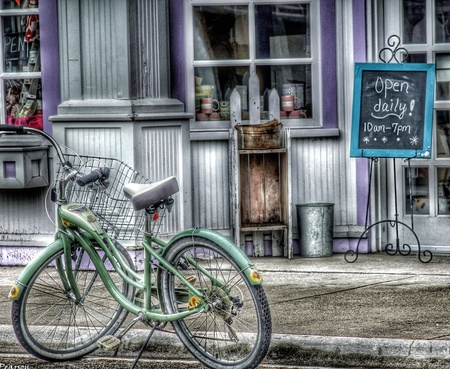 Photo of a bicycle parked in front of a shop on Mackinac Island