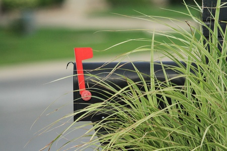 black mailbox with the red flag up Stock Photo
