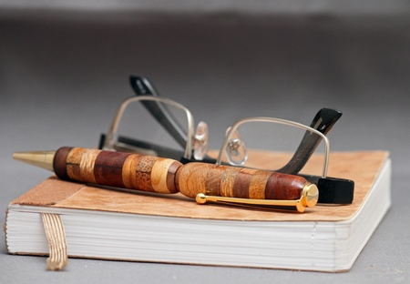 Small notebook with glasses and a handmade pen