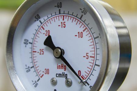 Vacuum pressure gauge meter in a close-up picture