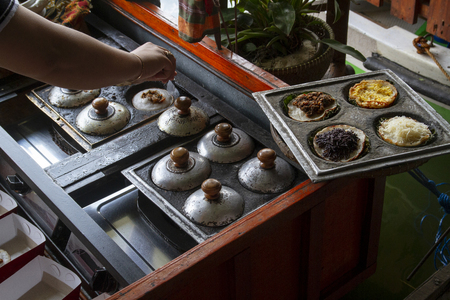 Traditional Indonesian pancake or serabi at a busy street food market