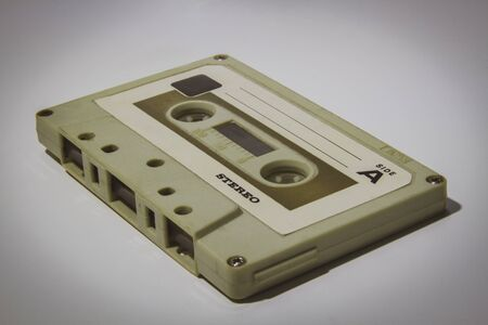 Old vintage white audio cassette tape close-up picture