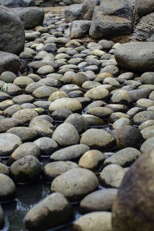 Beautiful naturally rounded stones in the dry pond 写真素材