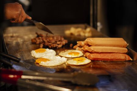 Street food seller prepare the food for customer