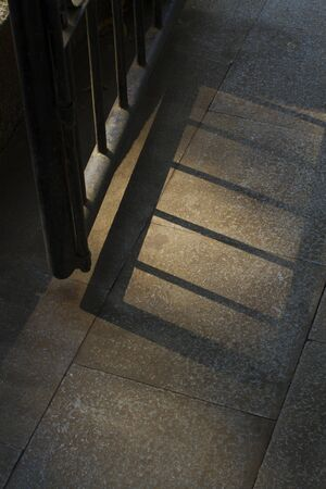 A photograph of park gate silhouette on the floor in the morning Banque d'images - 133062211