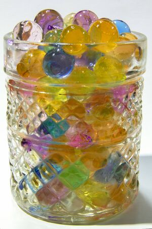 Close-up shiny and colourful water beads in the drinking glass Stock Photo