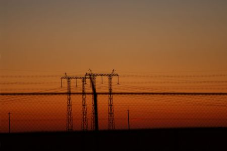 high-voltage wires on a columns behind an enclosure with barbed wire Stock Photo - 4992995