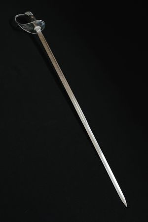 irrelevant: Long metal sword on a black background
