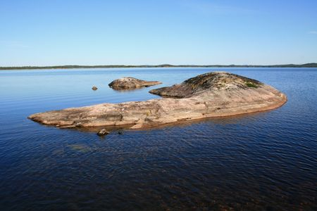 insipid: The archipelago consisting of several stones in transparent water of the big lake
