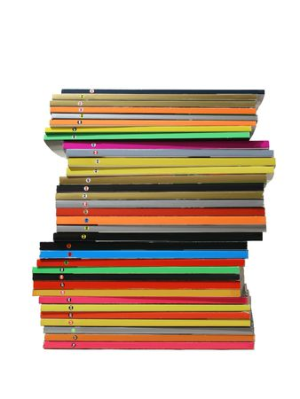 The big rough pile of shabby glossy magazines with multi-coloured bindings on a white background Stock Photo
