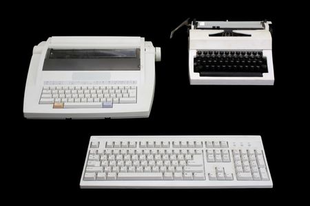 modernize: Two  white typewriters of different generations and computer keyboard on a black background.