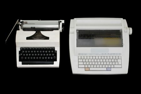 modernize: Two  white typewriters of different generations on a black background. The top view.
