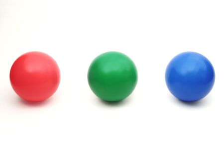 Three color balls - red, green and blue in a row on a white background photo