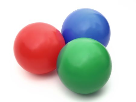 Three color balls - red, green and blue on a white background photo