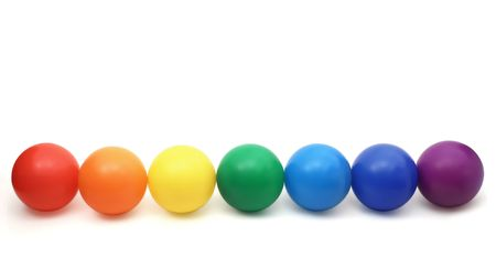 seven color balls - red, orange, yellow, green cyan, blue and magenta in a row on a white background
