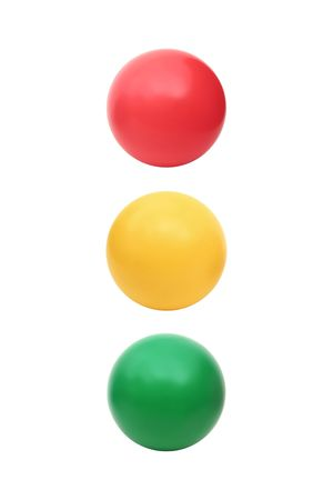 Three color balls - red, yellow and green in a row isolated on a white background