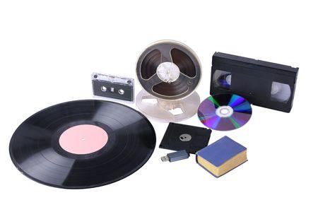 usb various: Different mediums: little blue book, magnetic tape bobbins, audio cassette, video cassette, 3,5