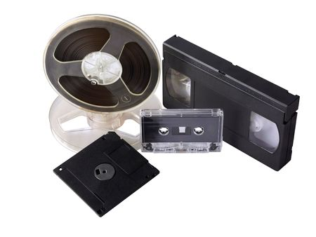 Different magnetic mediums: magnetic tape bobbin, audio cassette, video cassette, 3,5 photo
