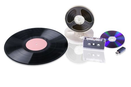 bobbin: Different music mediums in chronological range: gramophone record; magnetic tape bobbin, audio cassette, compact disc, USB flash drive. They are isolated over white. Stock Photo