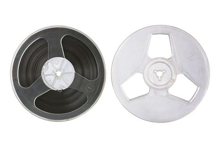 Two plastic reels isolated over white. One with magnetic tape, the other without it.
