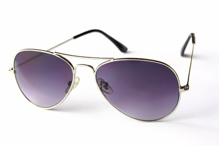 sun protection: sunglasses stands on white background