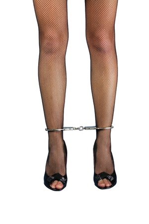A pair of handcuffed female legs in pantyhose photo