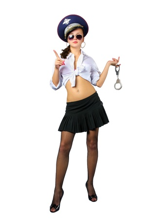 Young attractive woman in policeman costume with handcuffs stands isolated on white background