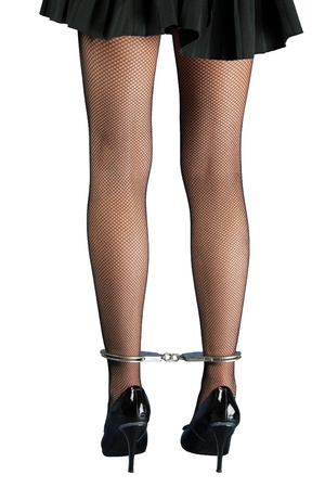 A pair of handcuffed female legs in pantyhose. Back view. Stock Photo - 8318425