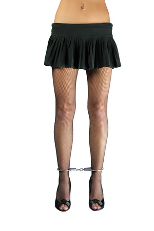 A pair of handcuffed female legs in pantyhose Stock Photo - 8318427