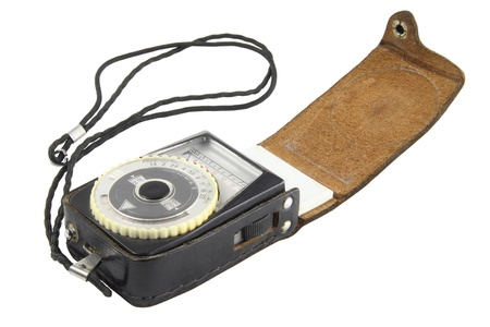 black analogue exposure meter isolated on white background photo