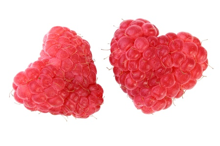 two ripe red heart-shaped raspberries over white backgroung photo