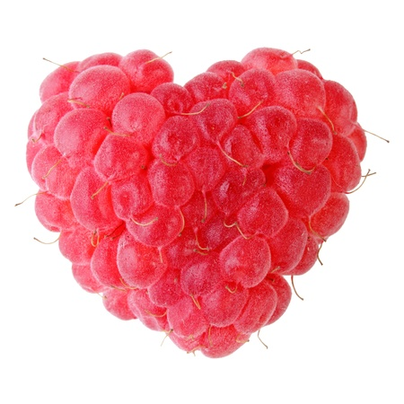 one ripe red heart-shaped raspberry over white backgroung photo