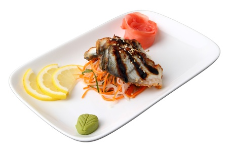 sashimi unagi with slices of smoked eel, lemon lobules, ginger and wasabi on rectangular dish isolated on a white background photo