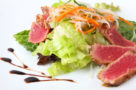 salad maguro sarada with slices of tuna on a white dish Stock Photo