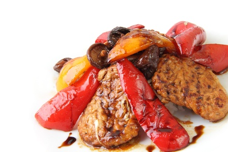 marinated pork with shiitake mushrooms and sweet peppers on white background photo