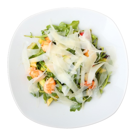 salad arugula with shrimps and cheese on white isolated dish. Top view. Stock Photo - 11624647