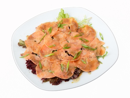 white dish with carpaccio of salmon on arugula over white background Stock Photo - 12071843