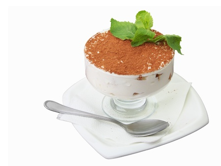 ornated: classic Italian tiramisu in glass  vase strewn by cacao and ornated with mint twig isolated on white background