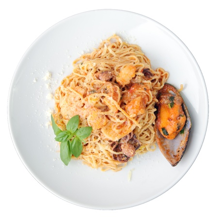 noodles tagliolini with seafood on a white plate isolated on a white background.