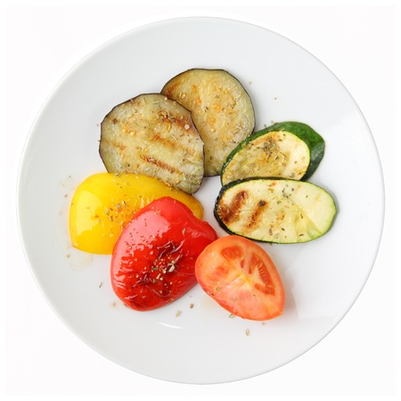 Grilled vegetables of different colors on white round dish isolated on a white background Stock Photo