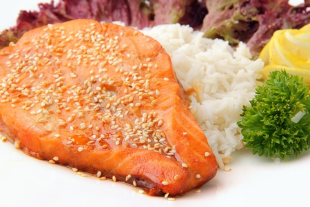 syake teriyaki - peace of salmon with rice on a white background photo
